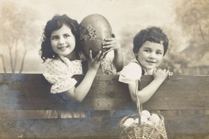 old photo  of happy young boy and girls with easter eggs.